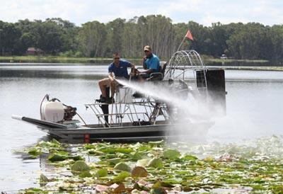 Spraying Aquatic Herbicides For Killing Pondweed