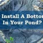 Installing a bottom filter in pond